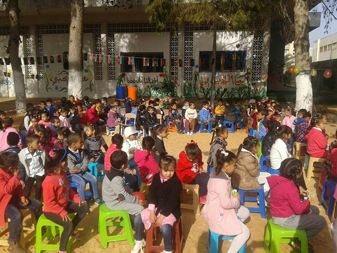 Photo taken by Sheikh Tahir Azzawi Charity Organization (STACO), a local non-governmental organisation supported by UNICEF, children sitting in Azzawiyah child friendly space run by STACO