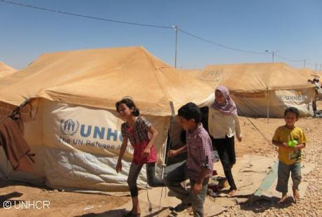 Refugees in Zaatri camp, Jordan, receive buckets, jerry cans and other relief items from UNHCR to help them survive and live in the camp while away from home. UNHCR's water and sanitation partner UNICEF have installed water points in the camp. Photo: UNHCR / A. Rummery