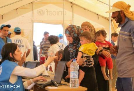 UNHCR staff registering Syrian refugees in Jordan at the Zaatri refugee camp. Photo: UNHCR / A. Rummery