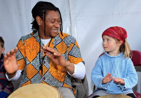 Uche Gabriel Akujobi leads the African drumming workshop helped along by Sally North (4) at the Irish Aid tent, Africa Day 2014