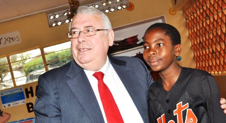 Minister Costello with Alan Tushabe, 15, at The AIDS Support Organisation, Central Uganda.