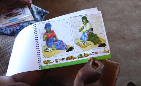 An information and training booklet on breastfeeding is used at a breastfeeding workshop in Sierra Leone. Photo: Irish Aid/Paul Sheehan