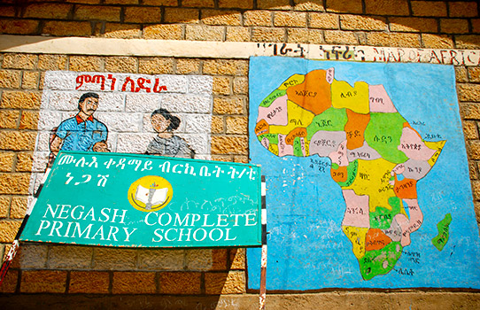 A map of Africa stuck onto the wall of a school