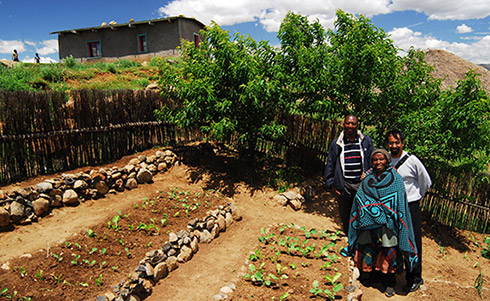 Lesothoian farmers with their crops Photo: Jeff Barbee