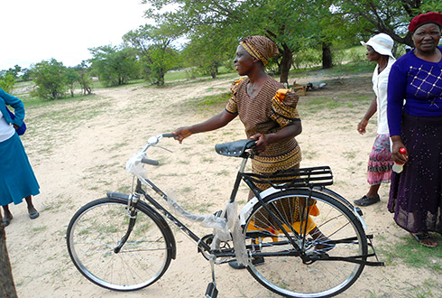 One of the caregivers receiving a bicycle for community home based care program