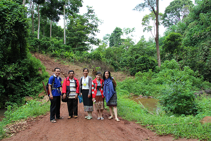 Áine (right) pictured with central and provincial Ministry of Health officials during an observation research field visit in Saravanne, Laos. ©: Áine Lynch / Unicef