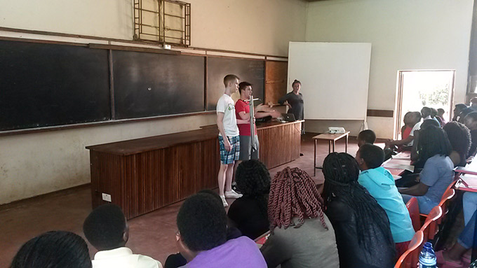 Diarmuid Curtin (right) and Jack O'Connor (left) presenting their award-winning ergonomic seed planter to students at Lilongwe University of Agriculture and Natural Resources, Malawi. Credit: Gorta Self Help Africa