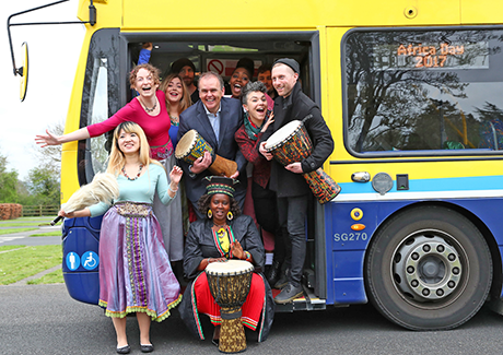 Minister McHugh with performers and Africa Day champions